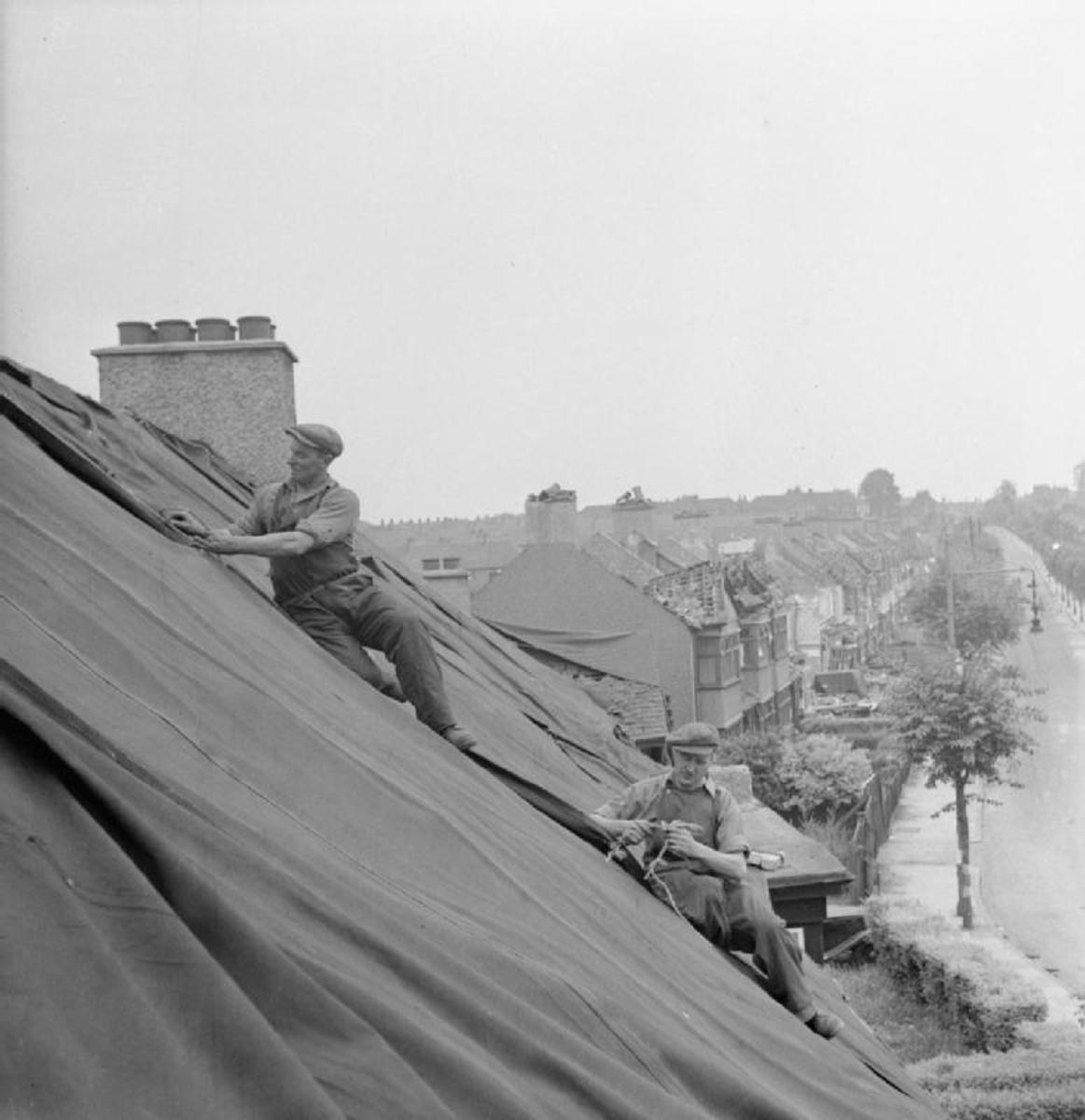 Repairing bomb damaged roofs with canvas sheet