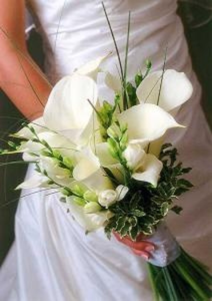 "In the classic white bouquet, only a few will be needed with some floral accents and variegated foliage. It creates a fresh and artistic flower bouquet that won't look fussy or ""over the top""."