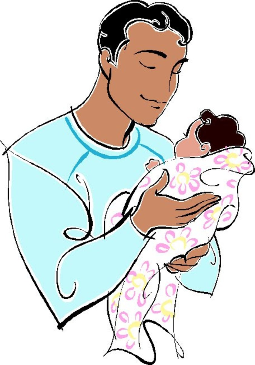 Picture of Dad Holding Baby Daughter
