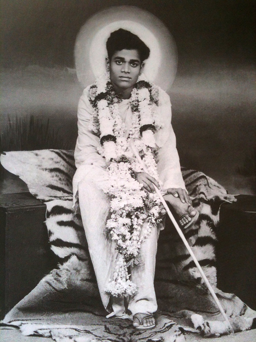 Baba in the early 1944. The photo has been taken in a studio in Bangalore when Swami acceded to the request of a devotee.