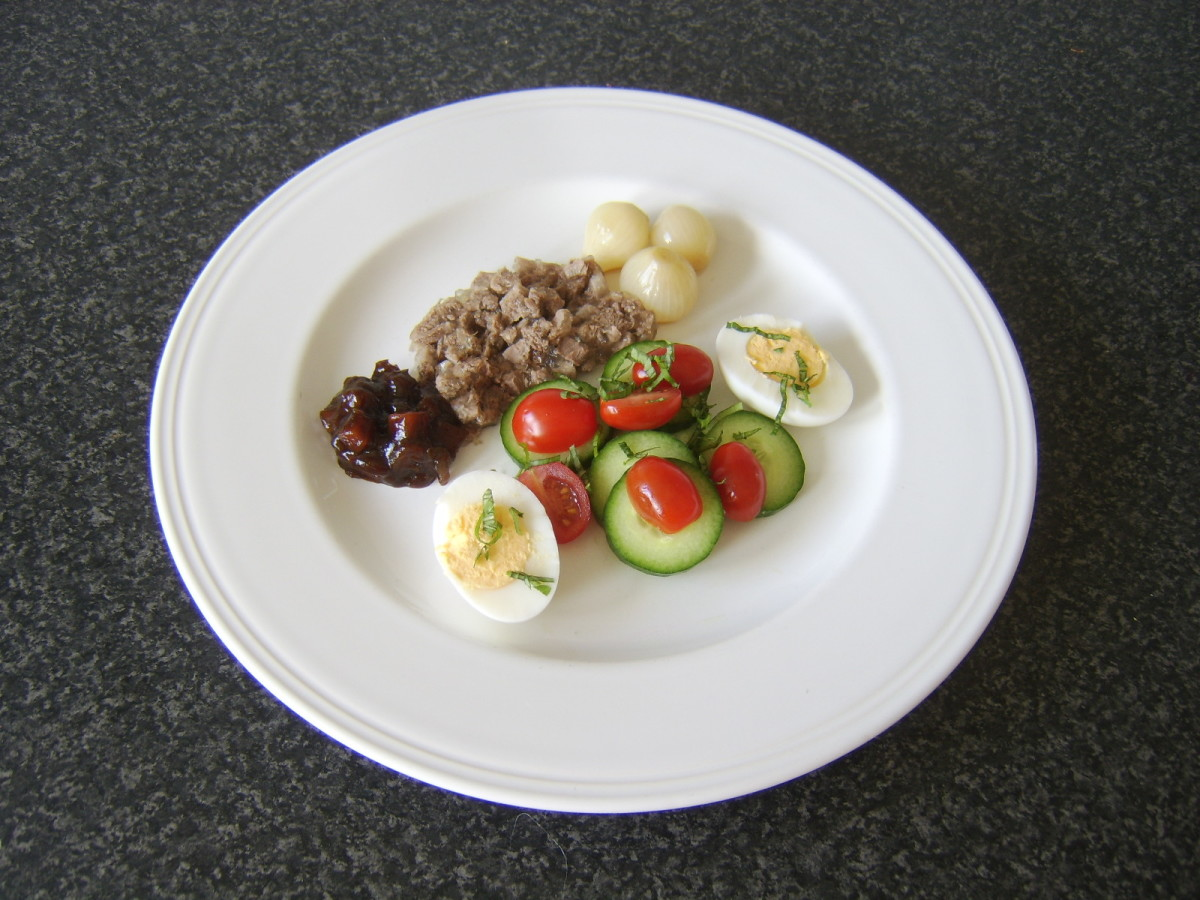 A thick slice of jellied beef tongue is served with a simple salad and pickles