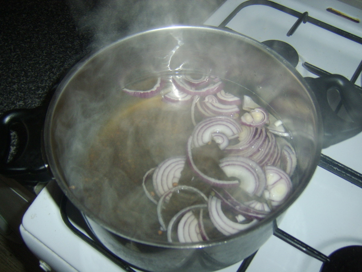 Green lentils and red onion are added to hot beef tongue broth