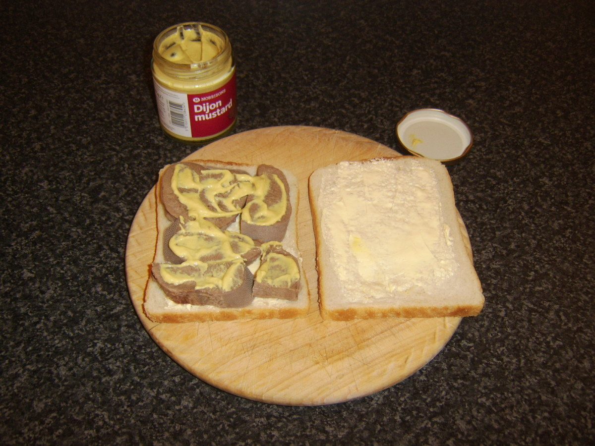 Dijon mustard is spread on the beef tongue