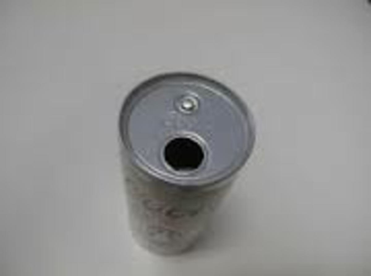 As requested a photo of Coors button top can.
