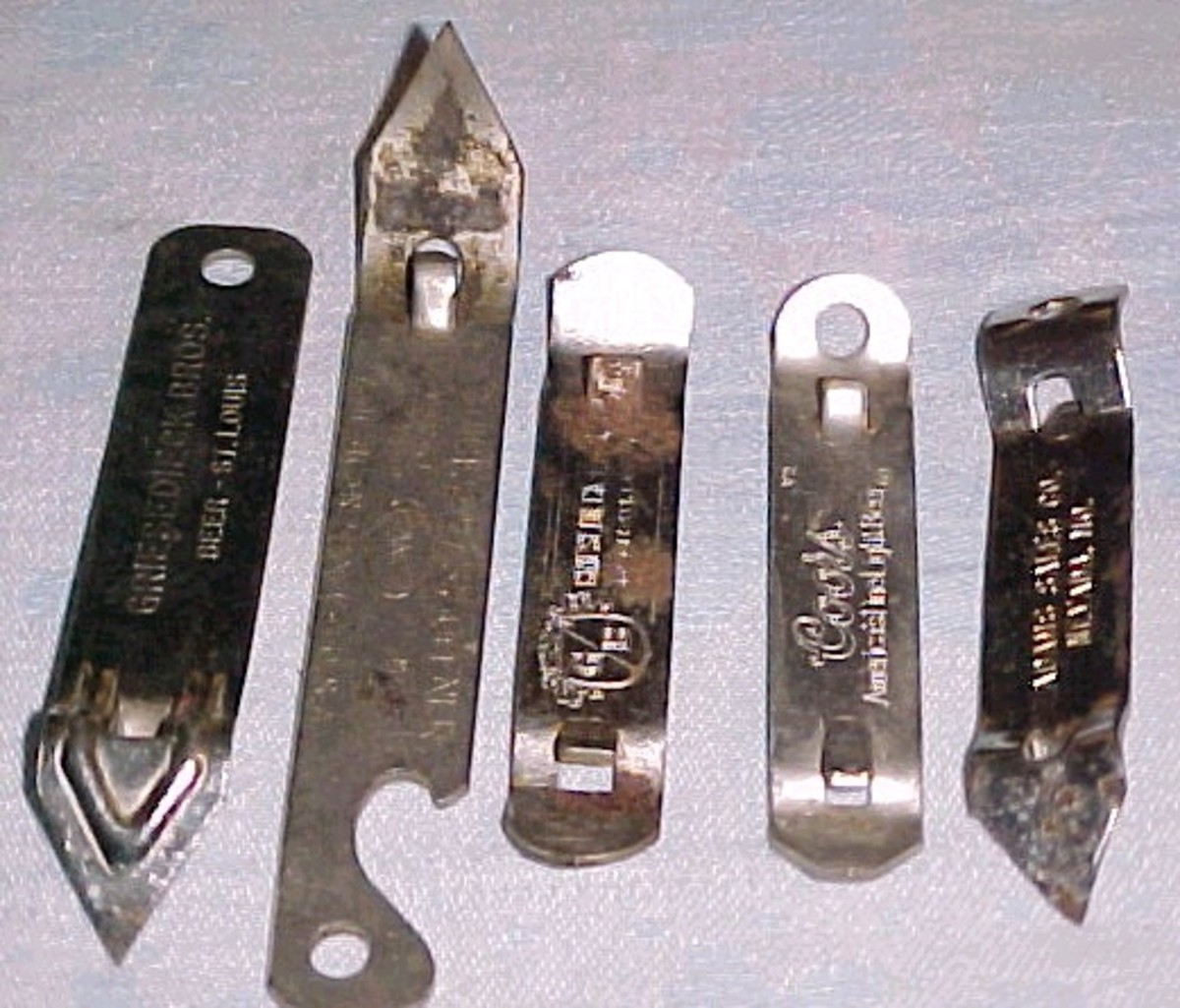 The magical church key opener that was needed to open the flat top beer can.