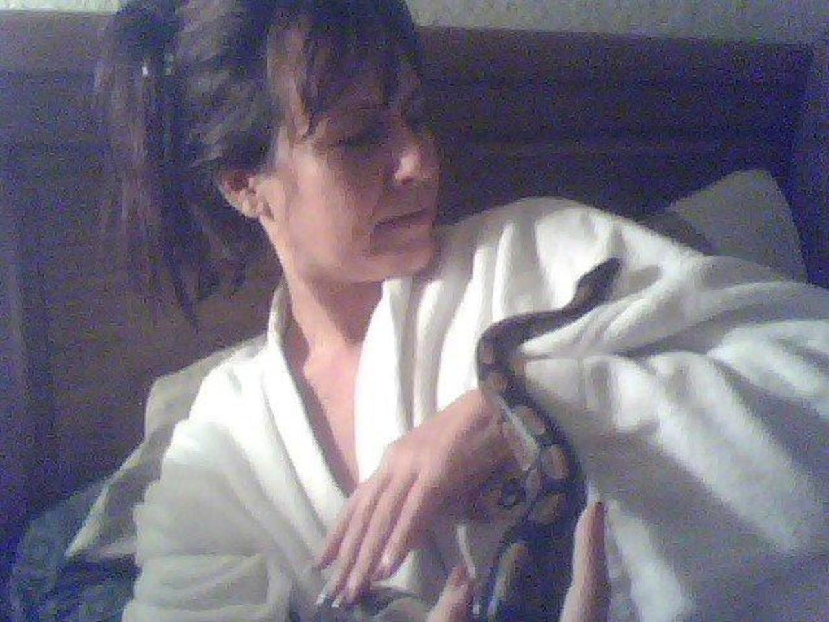 Here I am enjoying the company of my daughter's snake, Kimbo Slice.  He found me just as fascinating as I found him.