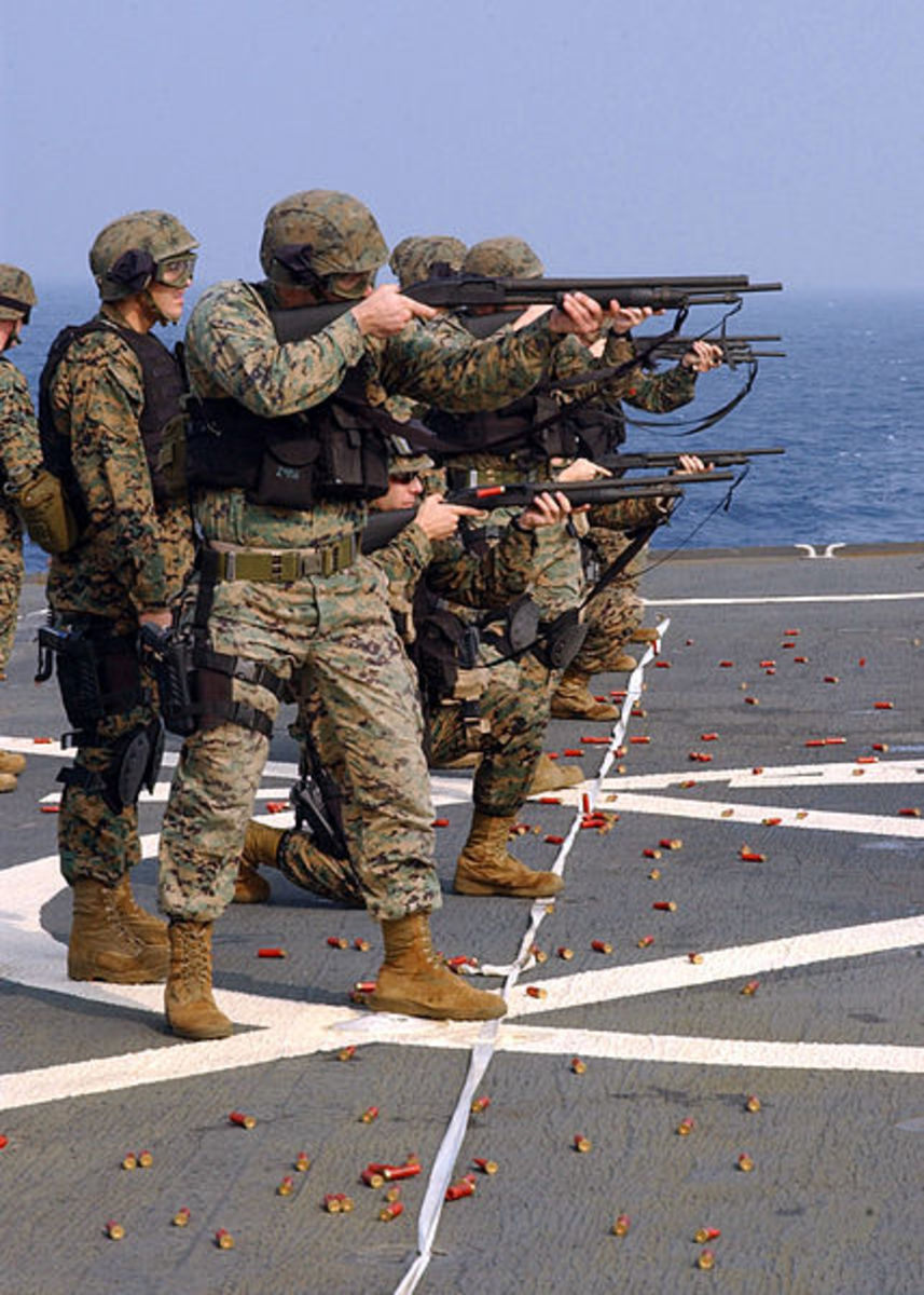 US Marines training with the Mossberg 590 on the deck of a US Navy ship