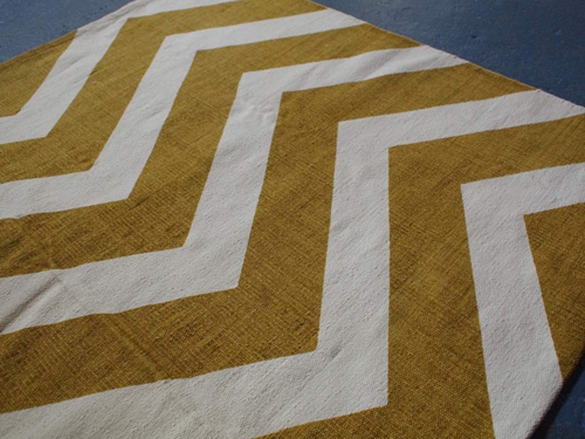 A chevron rug is a great component for a chevron themed bathroom.