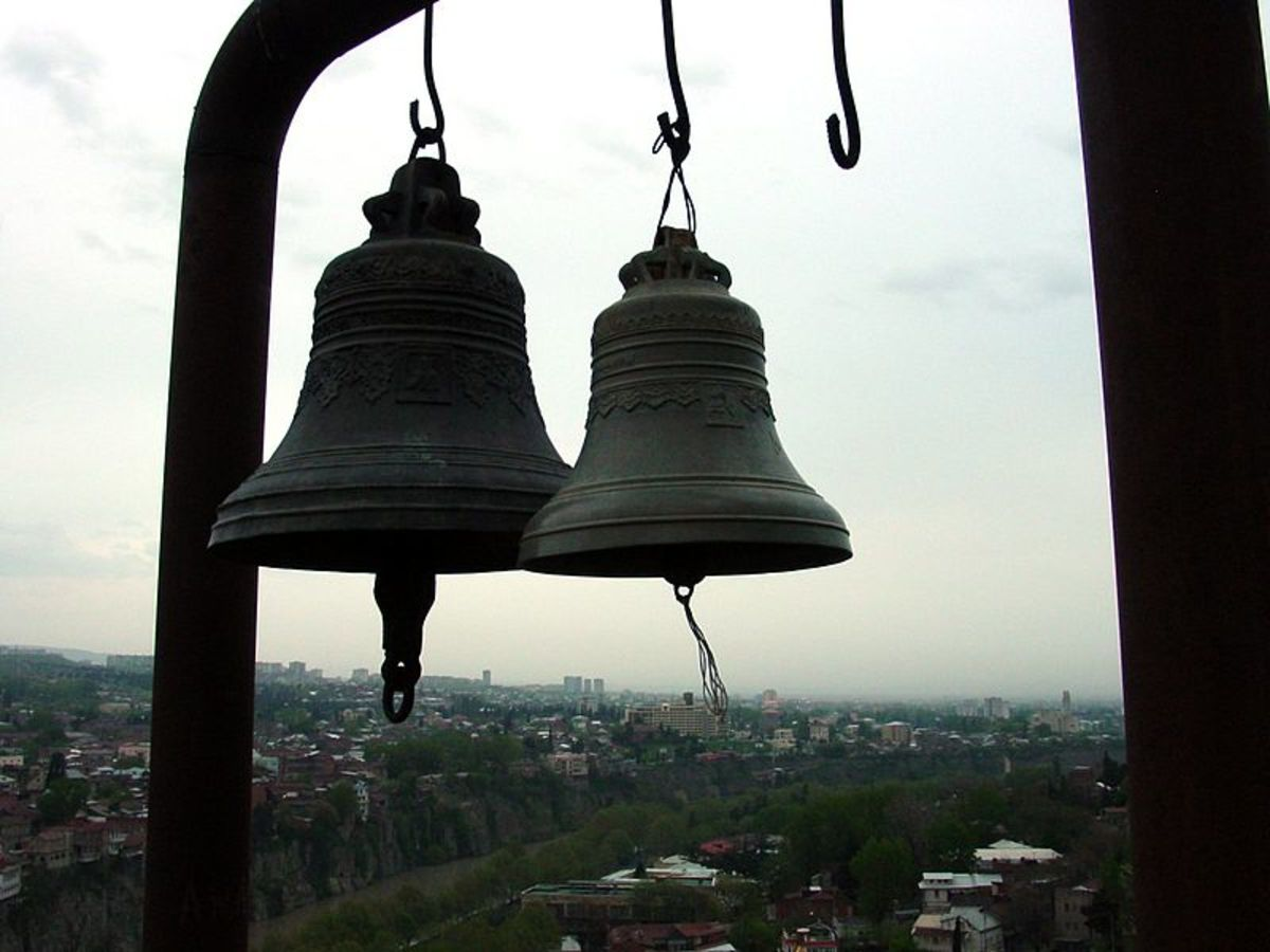 """Poe experiments with onomatopoeia, using the sounds of various bells to create mood in his poem """"Bells."""""""