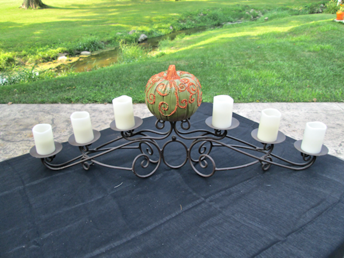 I placed the pumpkin on the center holder and the rest of the candles around it to see if I liked the basic design.