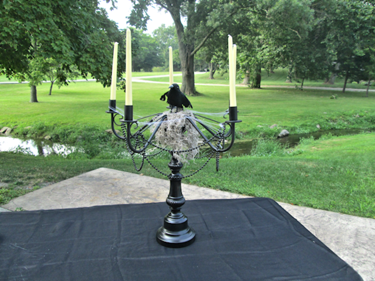 Add your crow or raven to the center (standing on the moss) and your taper candles.