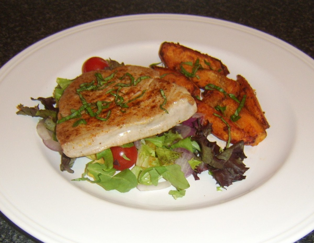 Paprika spiced tuna and sweet potato oven fries with salad