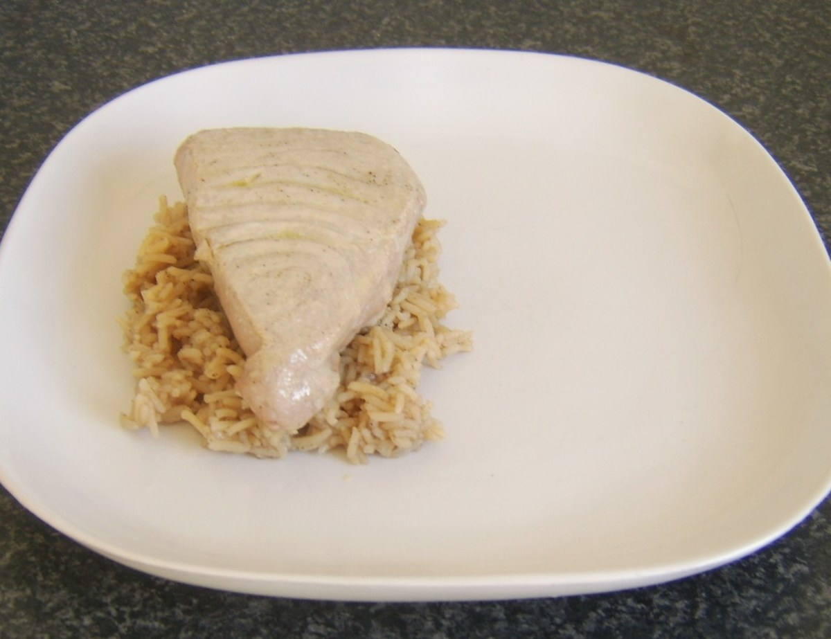 Tuna is laid on spiced rice bed
