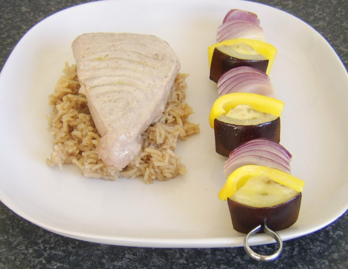 Vegetable shish kebab is plated with tuna and spicy rice