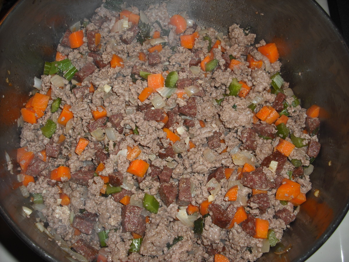 Add the meat and cook just until the meat is no longer pink.
