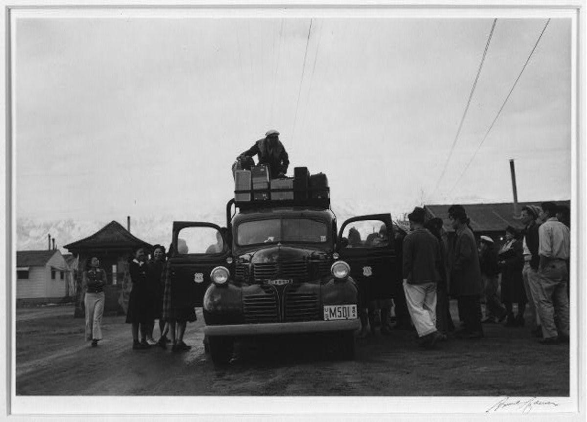 Leaving Manzanar to return home. Photograph by Ansel Adams.