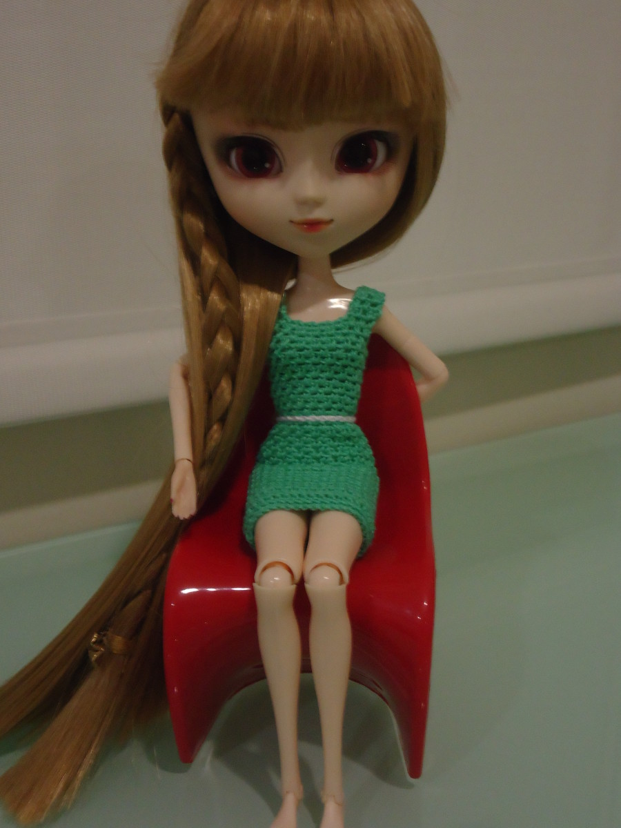 Pullip Belted Shift Dress while sitting on a Panton Chair