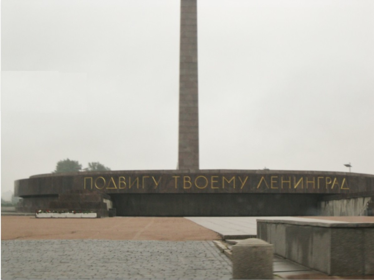 """Inscription below Obelisk in Victory Square in St. Petersburg, Russia.  Inscription translates to """"To Your Heroism Leningrad"""""""