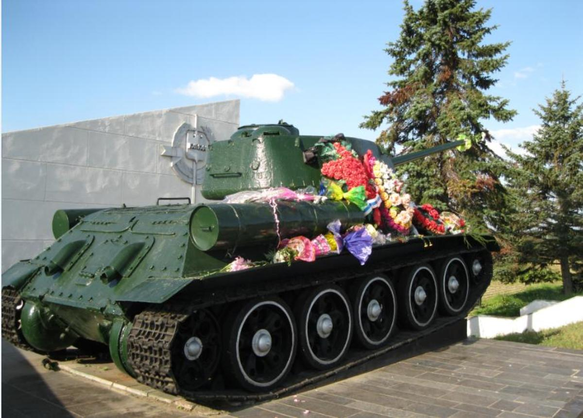 Soviet Tank at World War II Memorial in Field Outside Veliky Novgorod, Russia where Soviet fighters spent most of war while fighting Nazi Occupiers of the city.