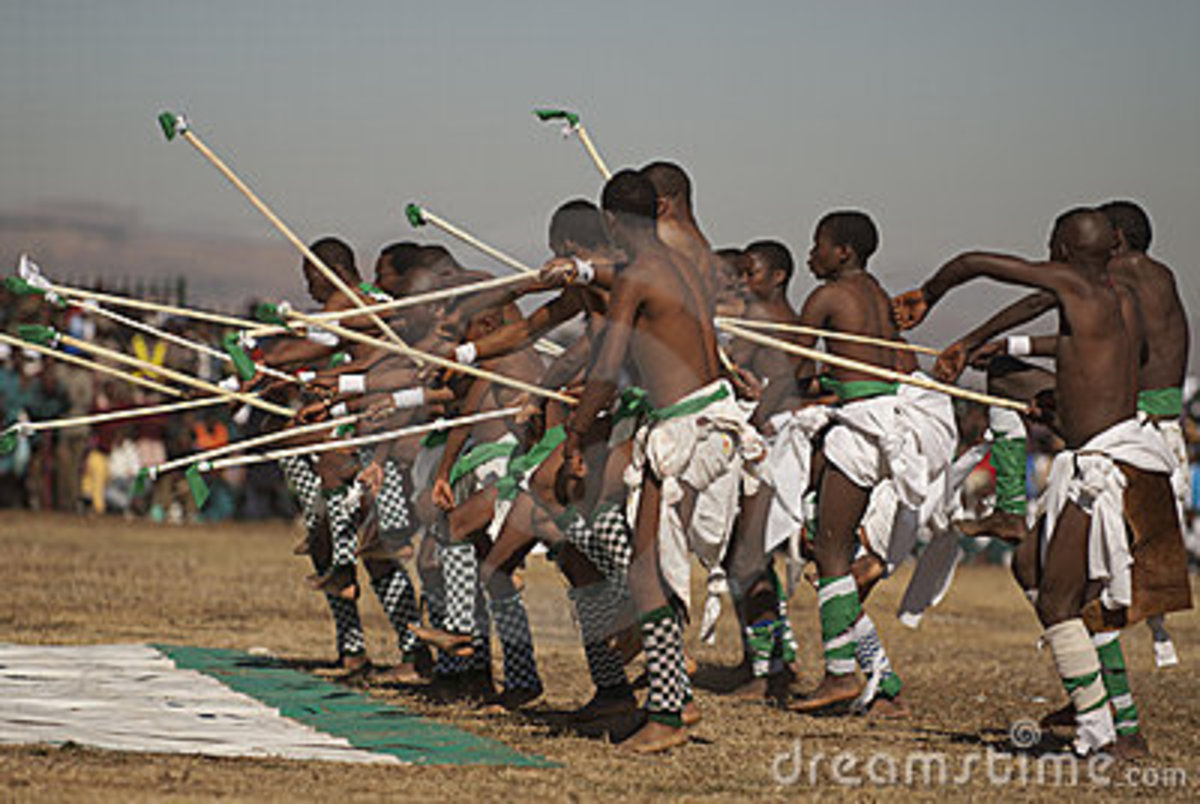 Basotho boys in traditional wear performing a traditional dance/song...