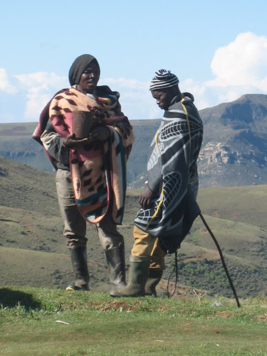 Basotho men Having a home-made beer and talking in the mountains of Lesotho