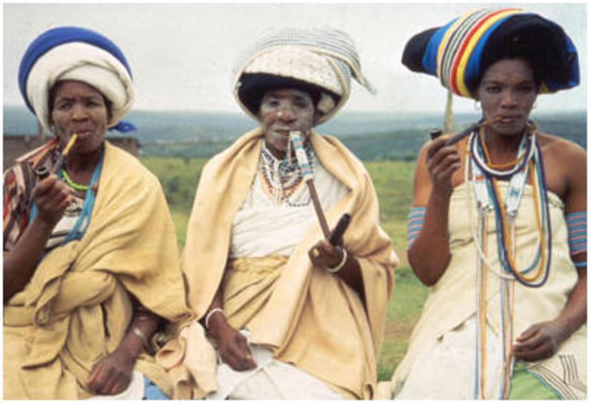 Xhosa Women Smoking their Traditional Pipes
