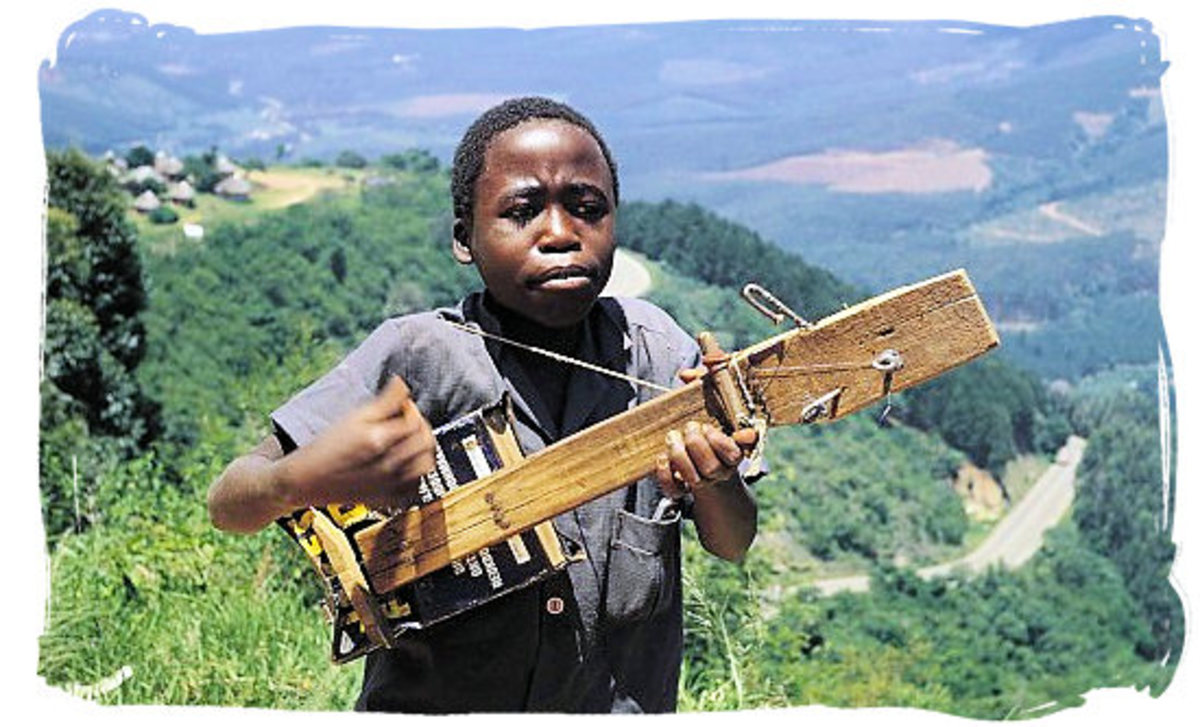 """South African boy playing his """"Home-Made"""" guitar"""