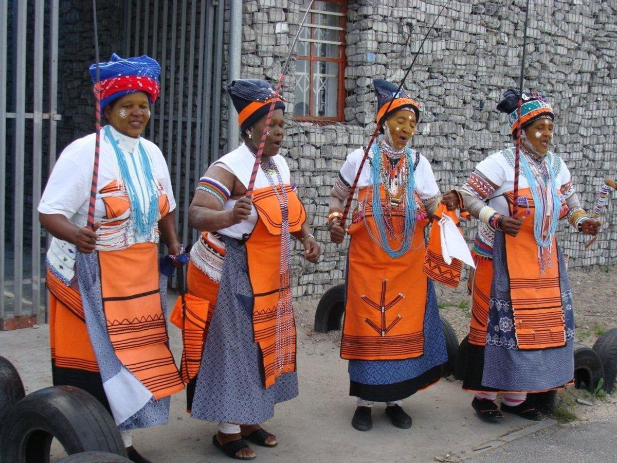 A group of wonderful Xhosa women, in the traditional dress of their culture. They sang and danced. They are highly respected elders in their society, whose duty it is to hand down stories in the oral tradition which will be lost without the likes of