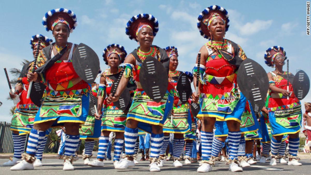 Zulu Women in full traditional and dance dress plus accessories