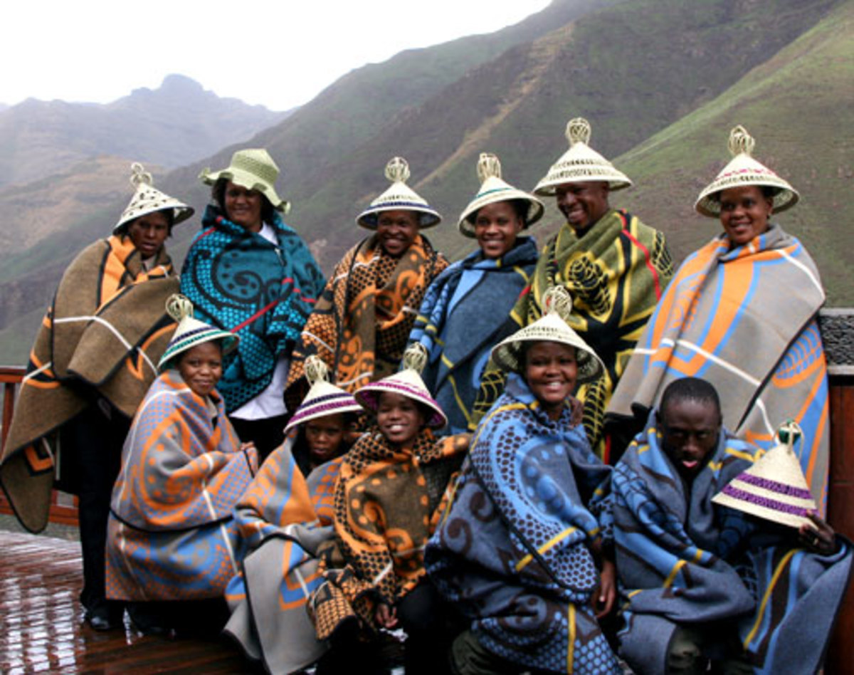 Basotho people wearing their traditional Blanket and sats