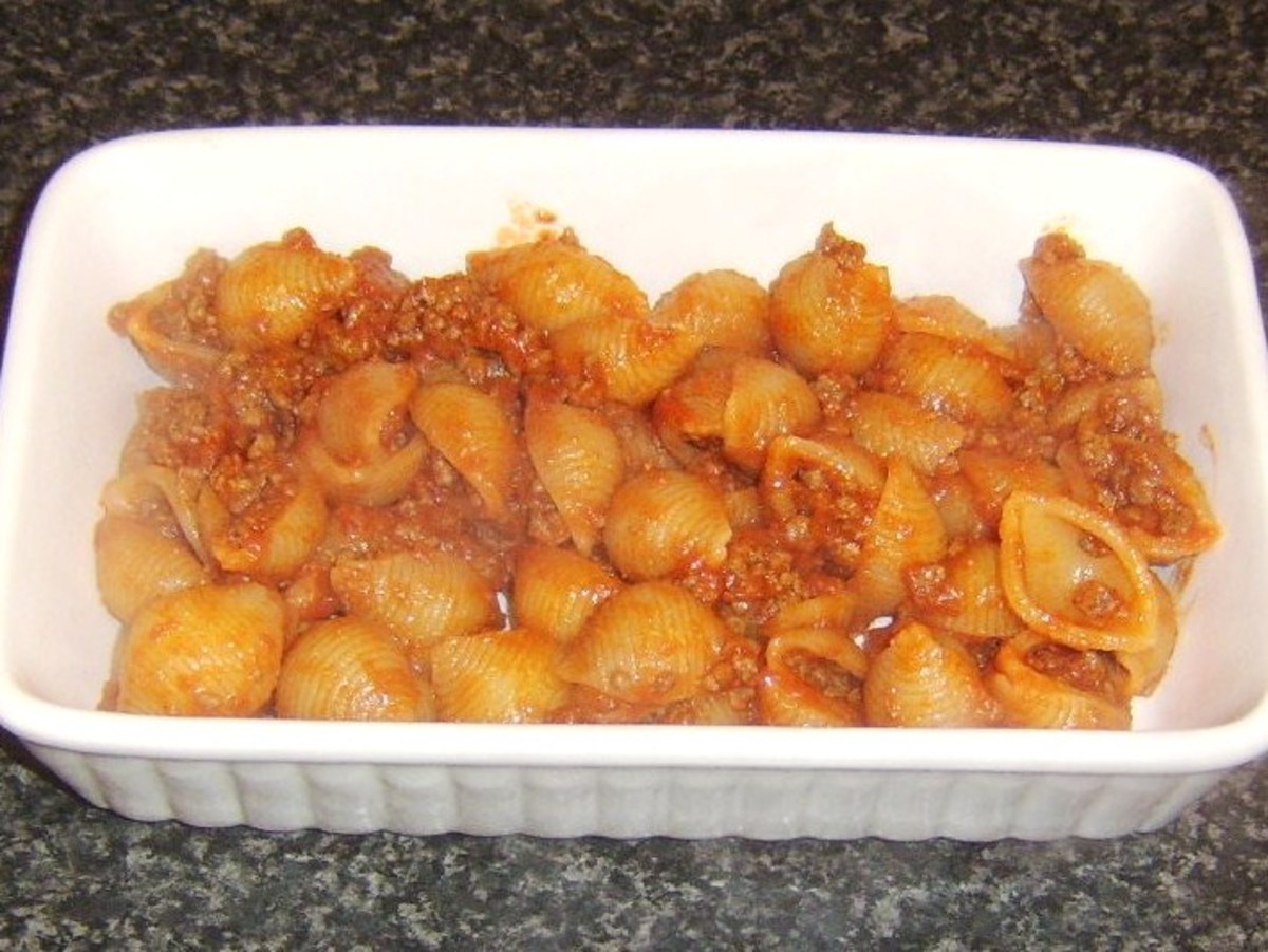 Conchiglie and beef is added to heatproof dish