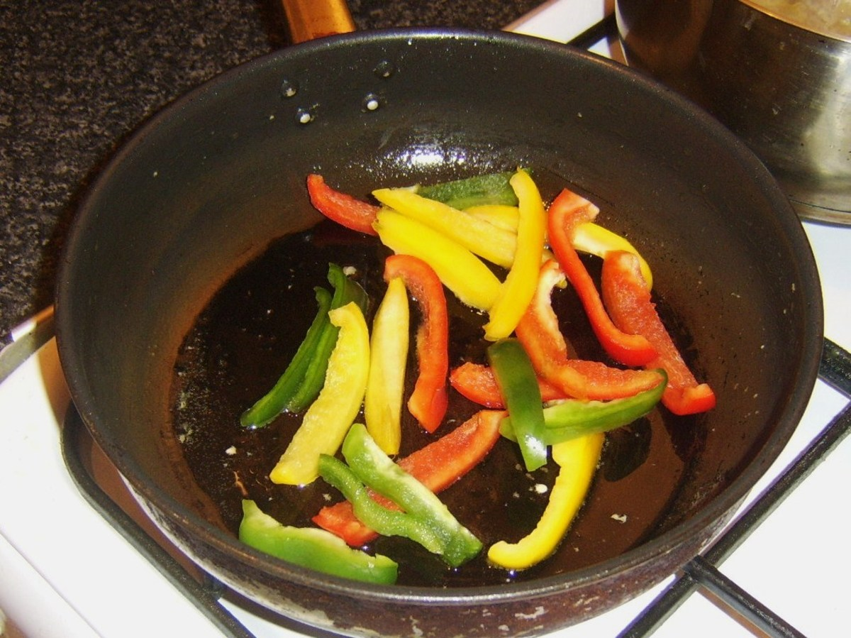 Frying bell peppers and garlic in olive oil