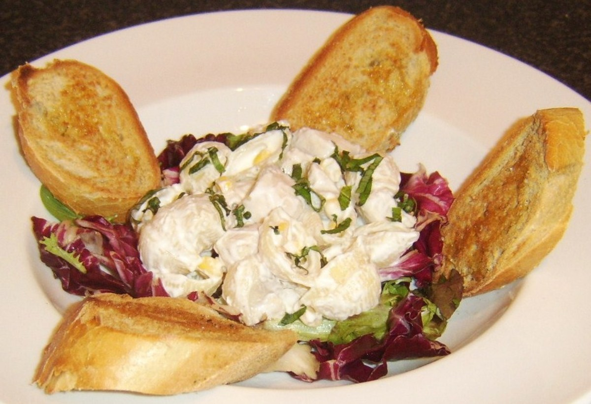 Cold chicken and conchiglie are made in to a sald with mayo and served on mixed salad leaves with bruschetta