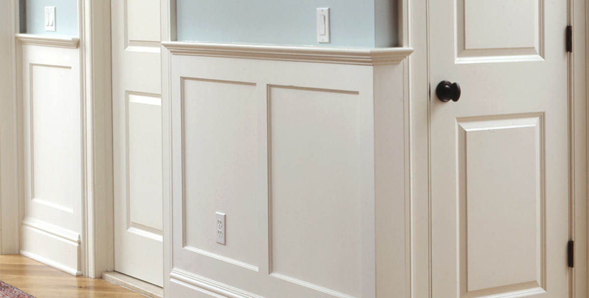 White wainscoting on a light blue neutral wall.