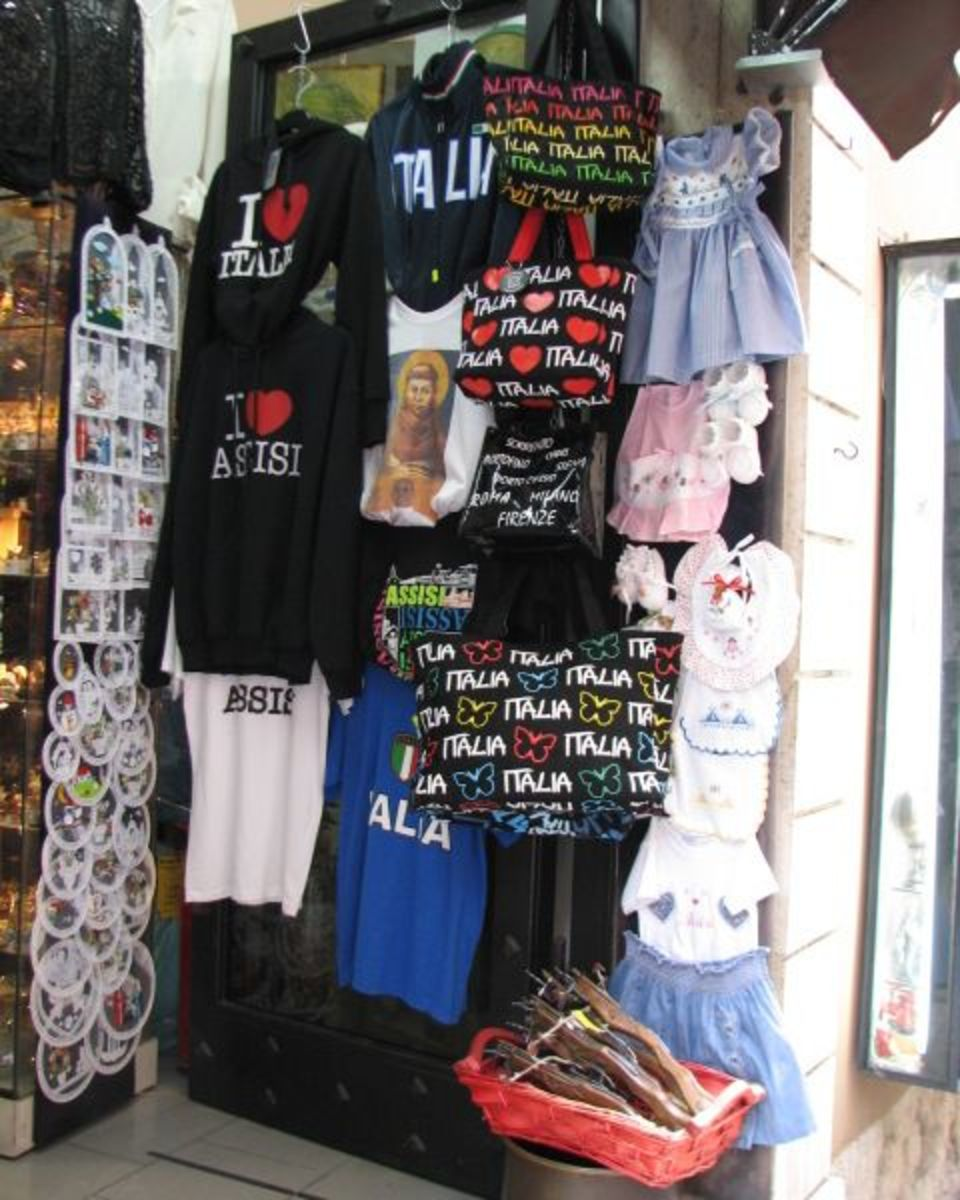 Display of typical tourist items outside a small souvenir shop near the Piazza di Commune (town square).