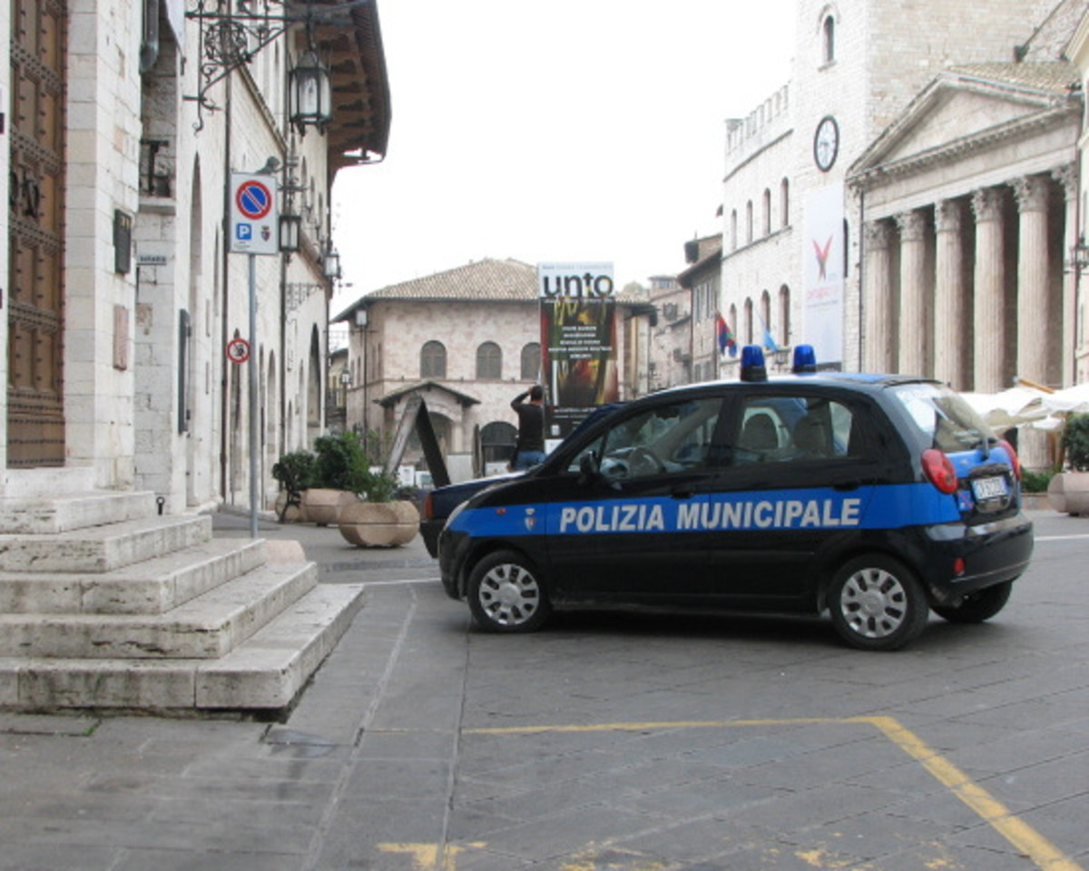 A typical hilltown police vehicle - a Fiat - made navigating the narrow twisting streets of Assisi doable.
