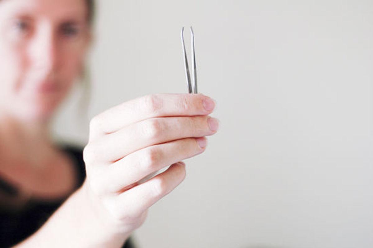 Plucking facial hair