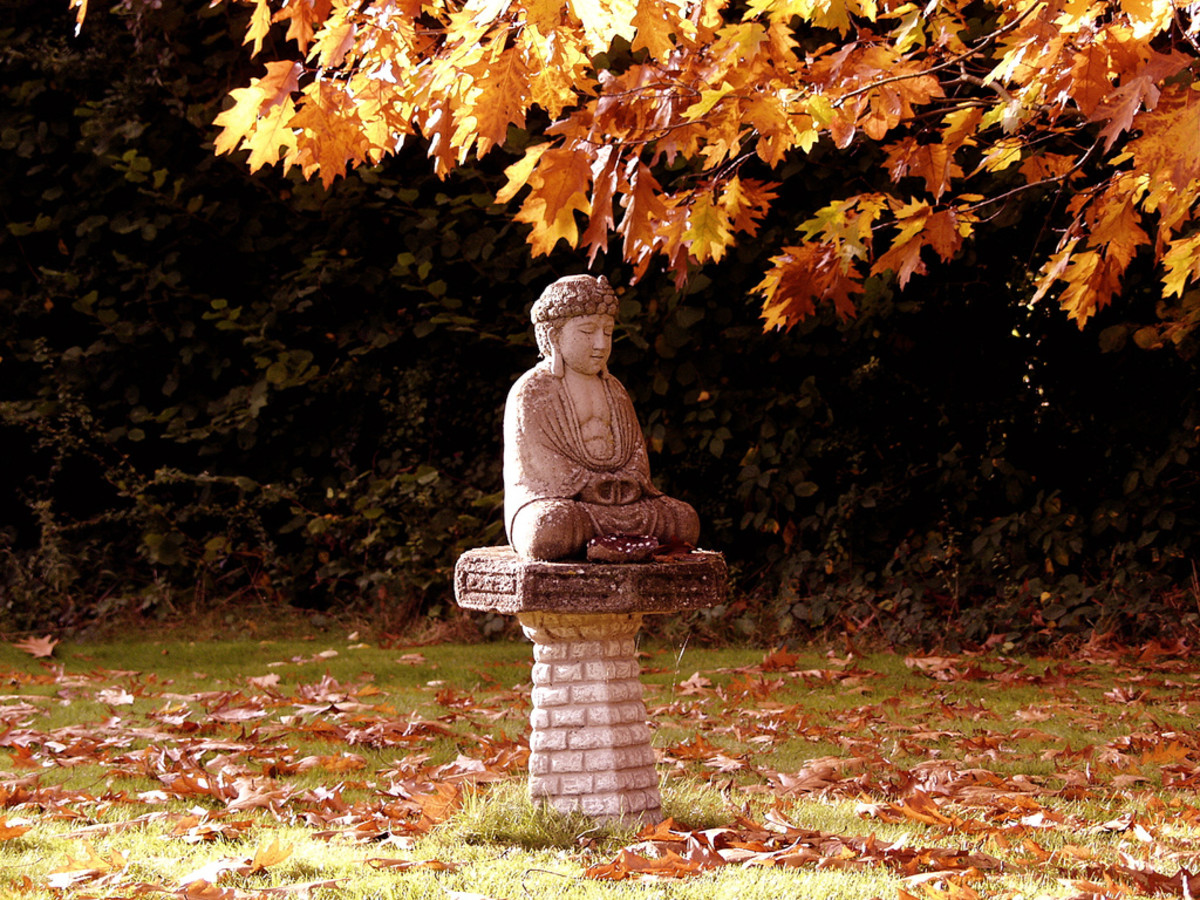 A Beautiful Buddhist statue within a Monastery. What do Buddhists believe about the afterlife? You will find out very shortly!