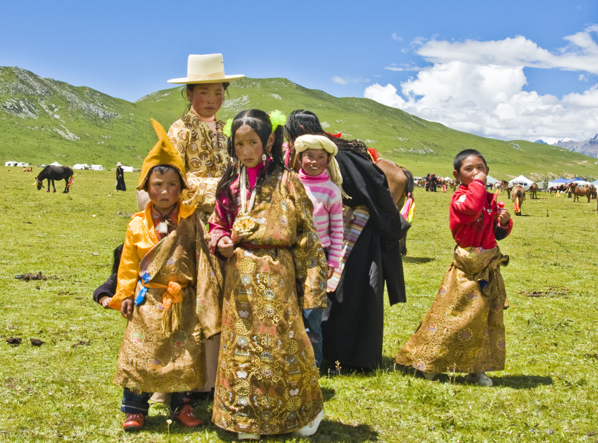 A traditional Tibetan family. Here, you can see the treeless landscape. Since there is permafrost trees and traditional burials don't thrive; further encouraging the long lived Tibetan Buddhist sky burial.