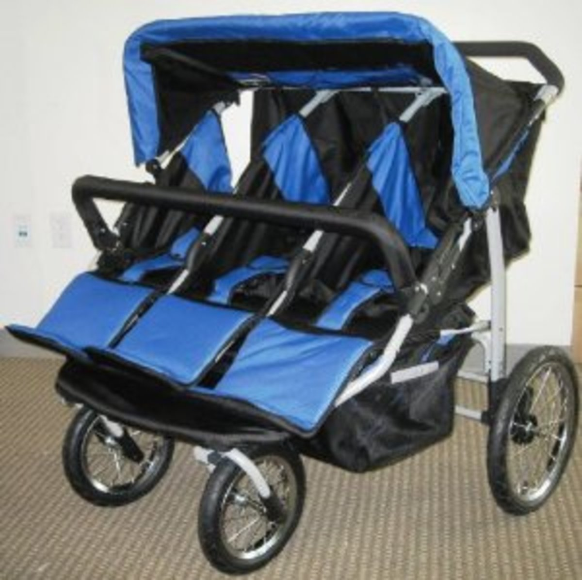 Blue and Black Triple Trio Baby Jogger Stroller with Rain Canopy