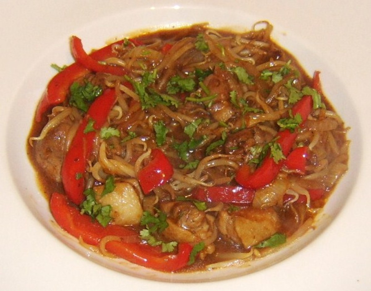 Duck leg meat Chinese stir fry with hoisin sauce and garlic