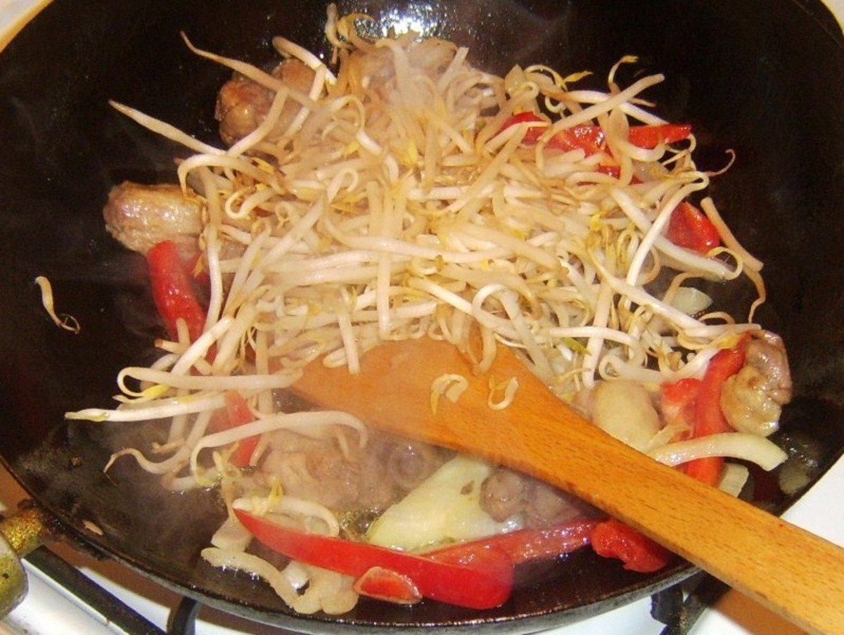 Beansprouts added to duck leg stir fry