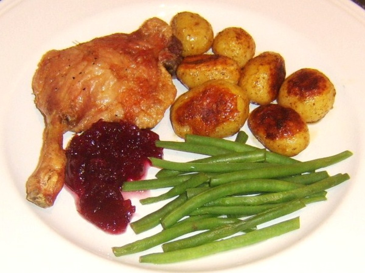 Oven roasted duck leg with duck fat roasted potatoes and cranberry sauce