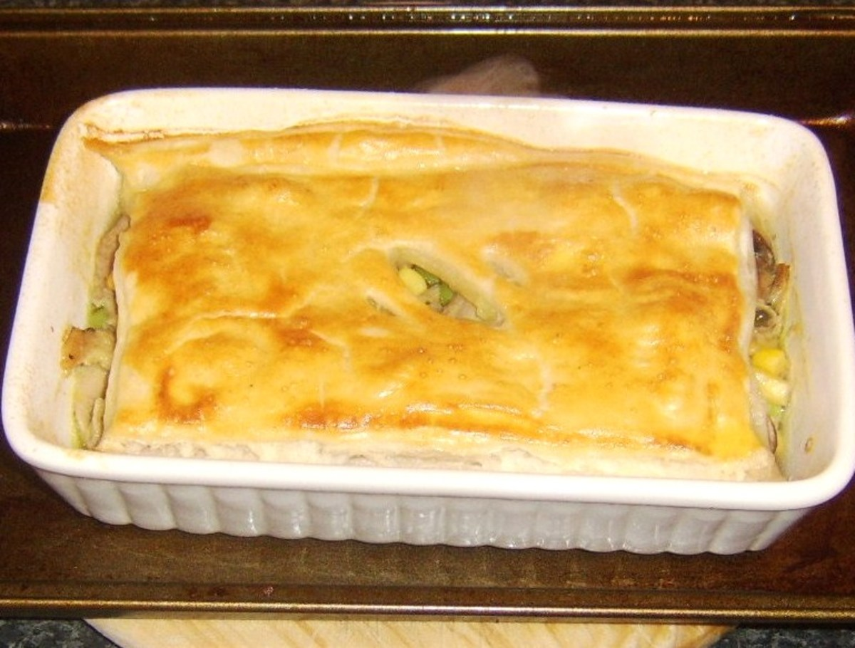 Duck leg and mushroom pie removed from the oven