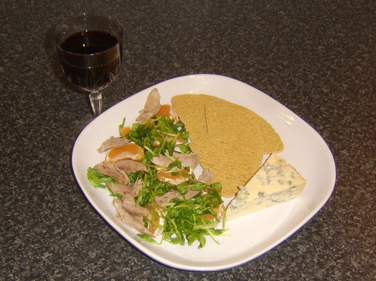 Simple poached duck leg salad with Stilton cheese, oatcakes and a glass of ruby port