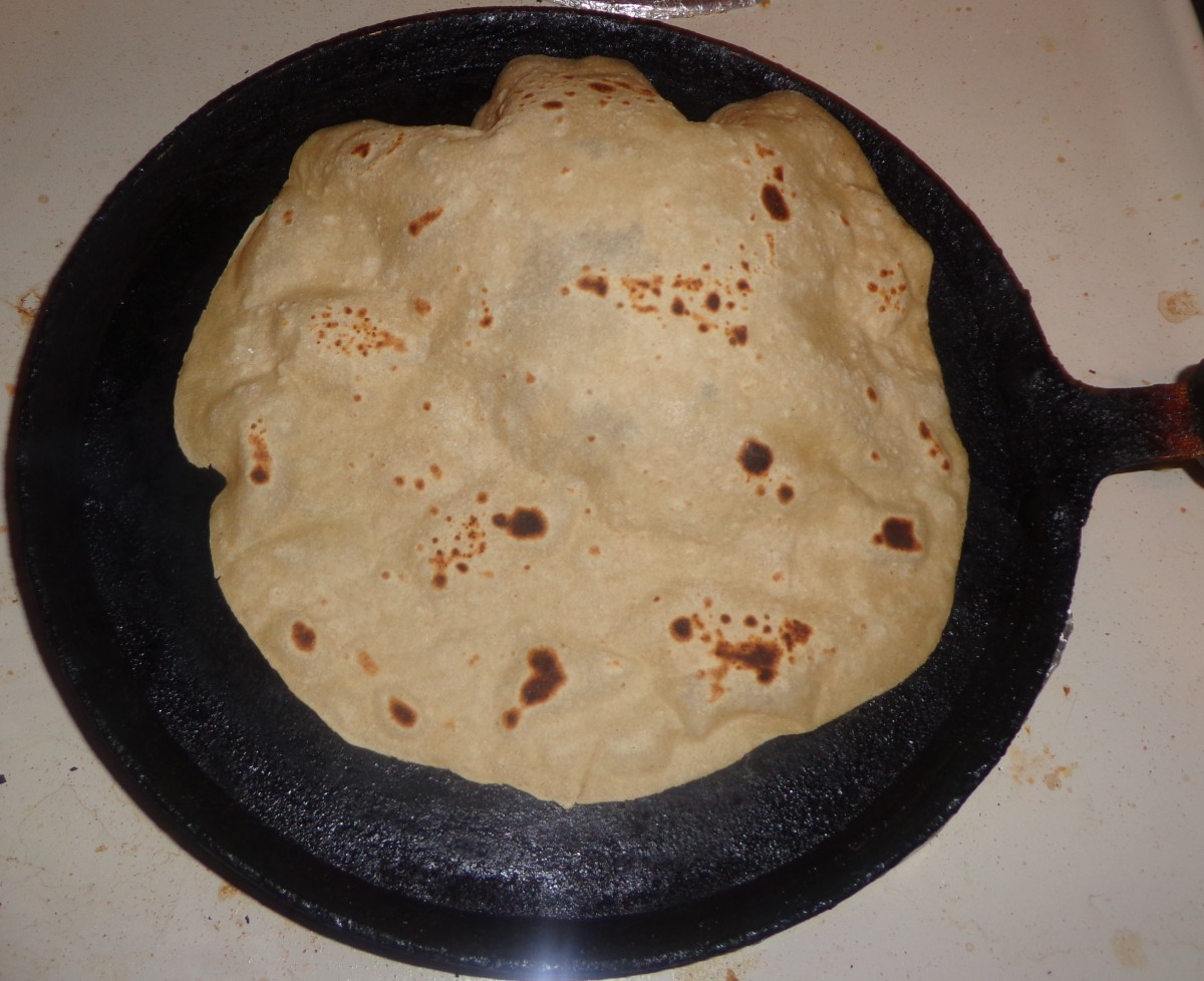 When u press the chapati with a cloth; after flipping it once, you can see the chapati bulging. Now shift the chapati to a separate plate. Your soft home made chapati is ready to serve.