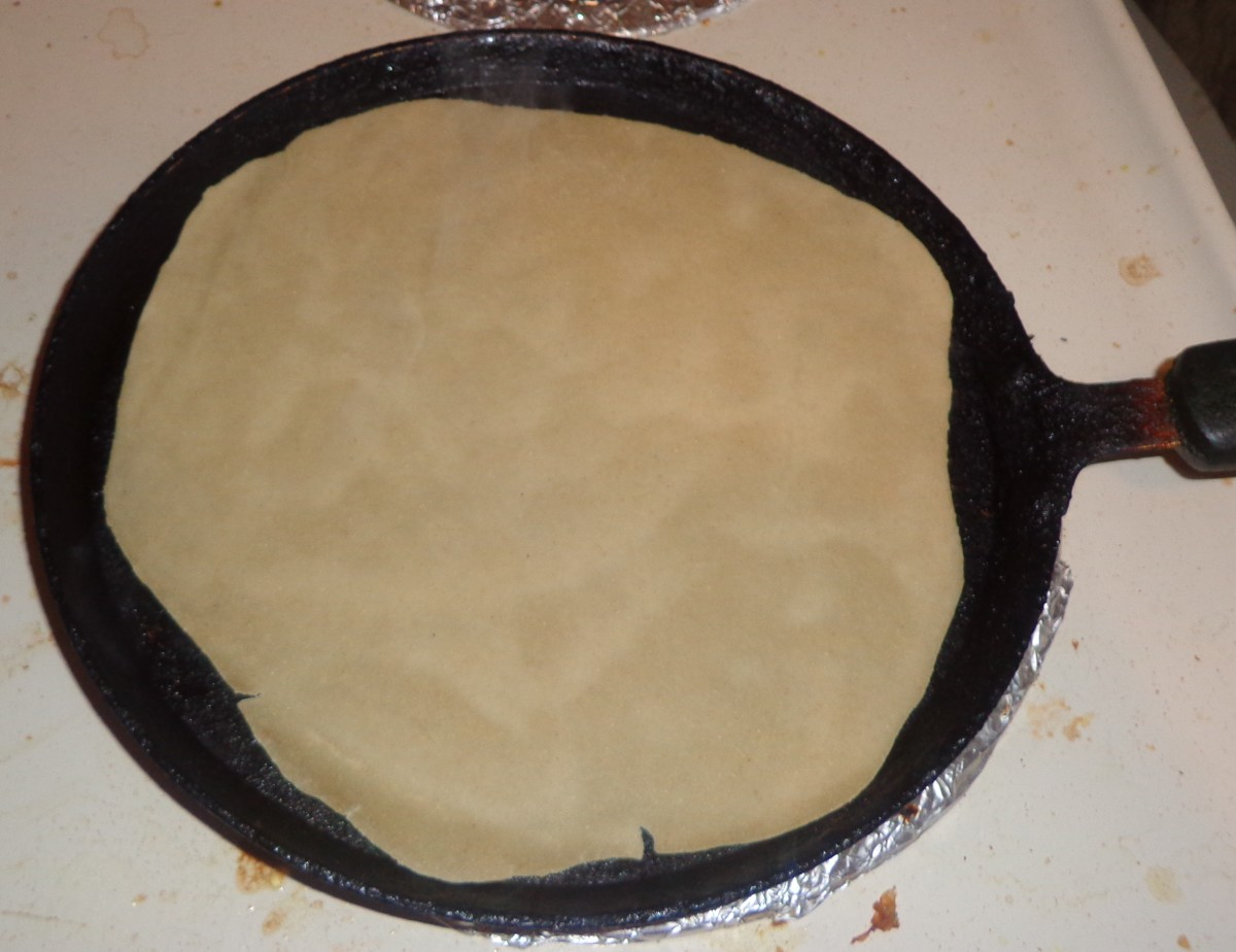 Place one rolled dough sheet on the tawa
