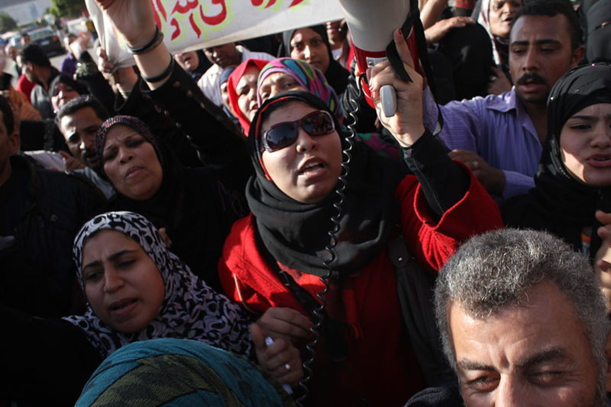 Egyptian women in protest on International Women's Day, wearing the ameera and the shayla style veils - both examples of an hijab