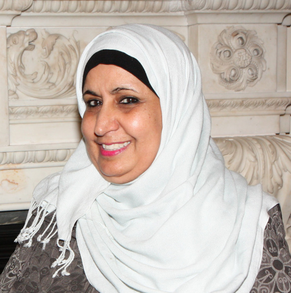 Saudi politican Norah Al Faiz in her pashmina scarf paired with an undercap and robe