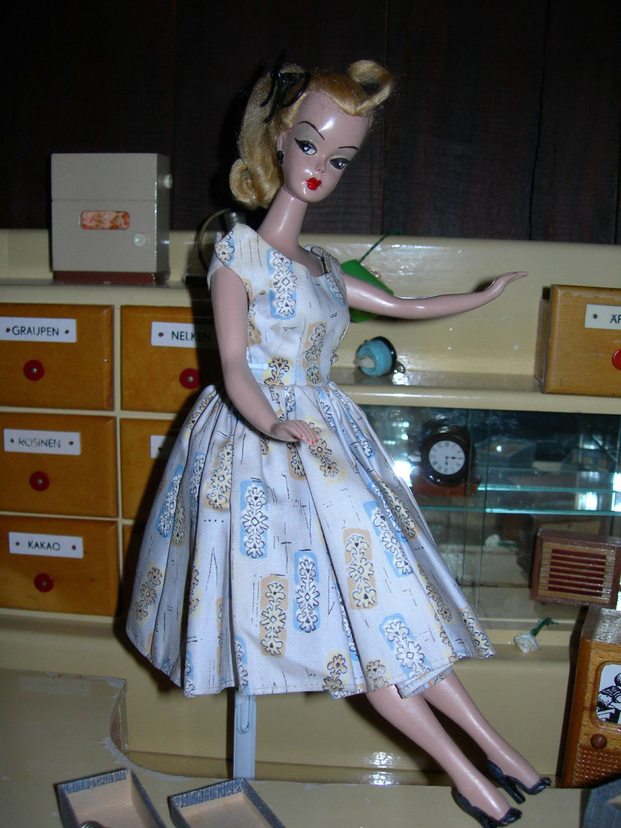 Lilli Doll The German Doll in a white print dress - the doll that Inspired Ruth Handler to create Barbie
